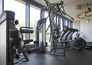 The fitness center and/or fitness facilities at HOOM Home & Hotel