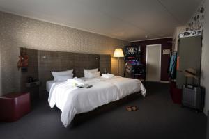 Кровать или кровати в номере pentahotel Kassel