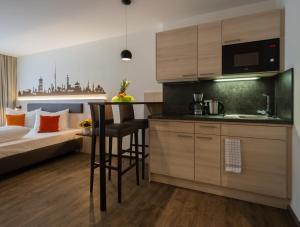 A kitchen or kitchenette at Garni Hotel Schumacher