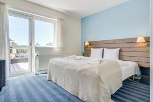 En eller flere senge i et værelse på Skagen Harbour Hotel