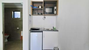 A kitchen or kitchenette at Hippo Lodge Apartments