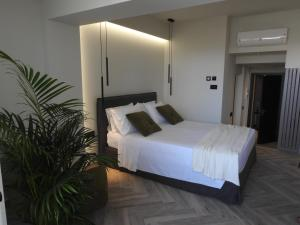 Ένα ή περισσότερα κρεβάτια σε δωμάτιο στο Nikos Ikies