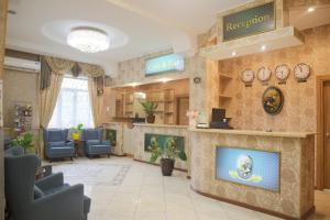 The lobby or reception area at Alva Donna Hotel
