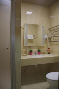A bathroom at Alva Donna Hotel