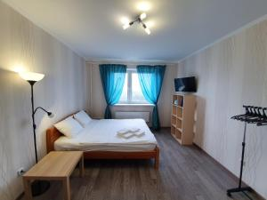 A bed or beds in a room at Щёлковские квартиры - Фряновское шоссе 64к3