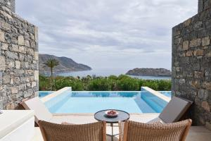 The swimming pool at or near Blue Palace, a Luxury Collection Resort and Spa, Crete