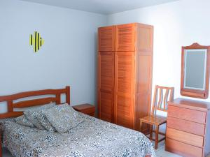 A bed or beds in a room at Pousada Mello