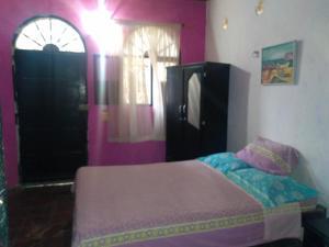 A bed or beds in a room at Casa El Garaje