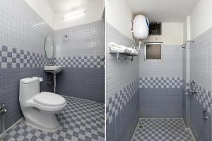 A bathroom at OYO 8891 Nancy Residency