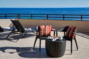 A balcony or terrace at Radisson Blu Resort, Malta St. Julian's