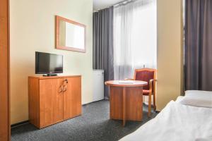 Telewizja i/lub zestaw kina domowego w obiekcie Gdański Dom Turystyczny Hostel