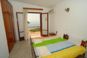 Ένα ή περισσότερα κρεβάτια σε δωμάτιο στο Villa Zaharo and Lilian Apartments