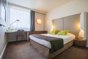 Łóżko lub łóżka w pokoju w obiekcie Campanile Bydgoszcz