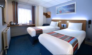 A bed or beds in a room at Travelodge Dublin Airport North 'Swords'