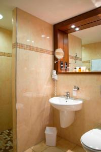 Ein Badezimmer in der Unterkunft Hotel Simon's Plaza