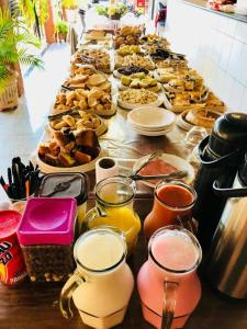 Opções de café da manhã disponíveis para hóspedes em Pousada Sol Nascente ll