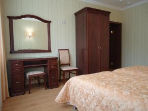 A bed or beds in a room at Apart-Hotel Kurkino