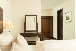 Ein Bett oder Betten in einem Zimmer der Unterkunft Best Western Soibelmanns Lutherstadt Wittenberg