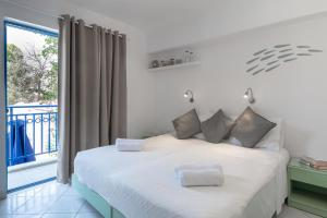 Ένα ή περισσότερα κρεβάτια σε δωμάτιο στο Hotel Nathalie
