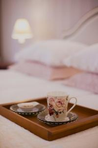 A bed or beds in a room at Pousada Pequena Tiradentes