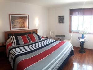 Cama o camas de una habitación en Nubes Hotel