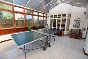 Ping-pong facilities at 5 Bedroom Beach Front Property or nearby