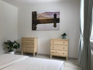 A bed or beds in a room at Apartmán Hodruša-Hámre
