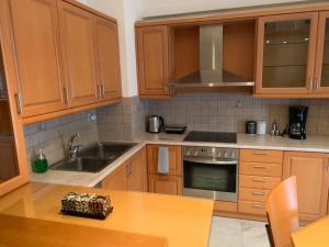 A kitchen or kitchenette at Danai's Loft
