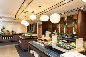 A restaurant or other place to eat at Vessel Hotel Campana Kyoto Gojo