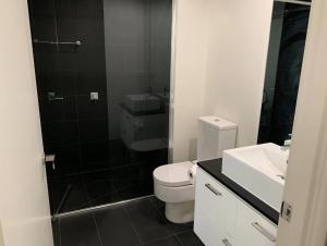 A bathroom at Essendon Apartments