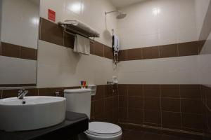 A bathroom at Adya Hotel Chenang