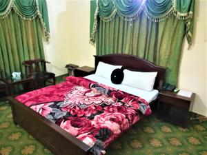A bed or beds in a room at The City Lodge