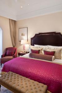 A bed or beds in a room at The Taj Mahal Palace, Mumbai