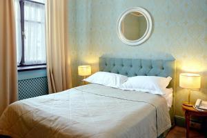 Кровать или кровати в номере Винсент Отель