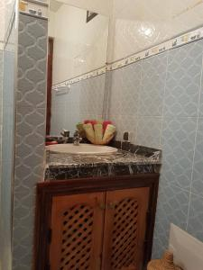 A bathroom at Zwina Appart: A Small, Cozy Family Nest