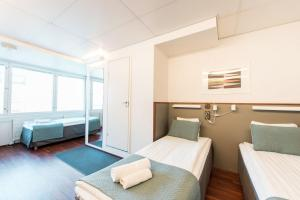 A bed or beds in a room at Forenom Aparthotel Helsinki Kamppi - contactless check-in