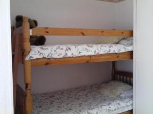A bunk bed or bunk beds in a room at Roseglen Hotel