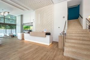 The lobby or reception area at Triton Hotel