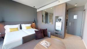 A bed or beds in a room at Melia Barcelona Sky 4* Sup