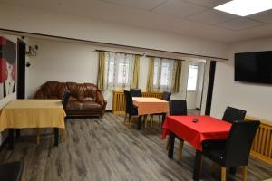 A seating area at Casa Caprioara