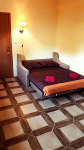 Кровать или кровати в номере Гостевой дом Дистанция