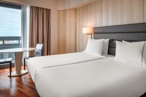 A bed or beds in a room at AC Hotel Gran Canaria