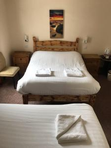 A bed or beds in a room at Royal Britannia Hotel
