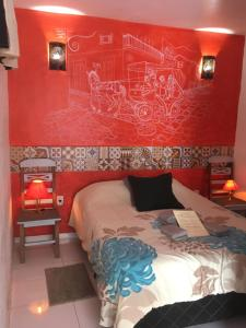 A bed or beds in a room at Paraty Mini Flat