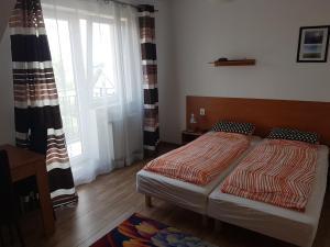 Łóżko lub łóżka w pokoju w obiekcie Villa ASTER