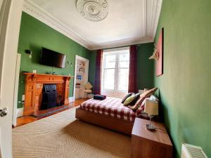 A television and/or entertainment center at Unwind At A Tranquil, Quirky Flat in West End