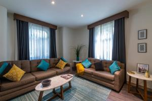 A seating area at Casa Malí by Dominion Boutique Hotel