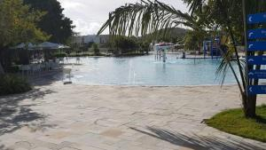 The swimming pool at or close to Residence Resort - Barra de São Miguel