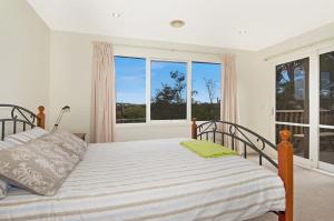 A bed or beds in a room at Jarrabinda