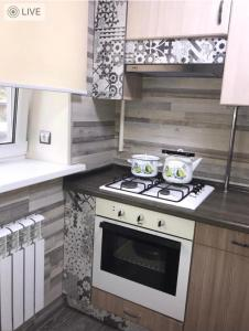 A kitchen or kitchenette at Ахметова 12
